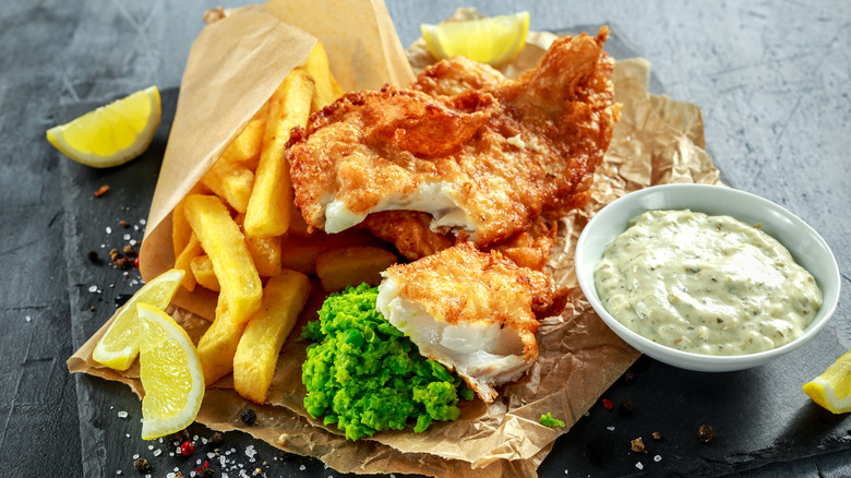 Fish and chips with lemon wedges and tartar sauce