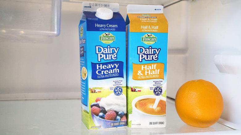 Cartons of half and half in refrigerator