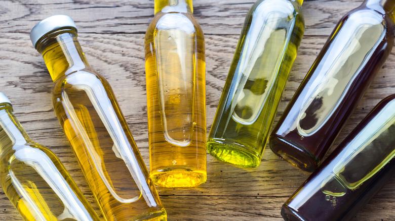 Bottles of oil on wood table