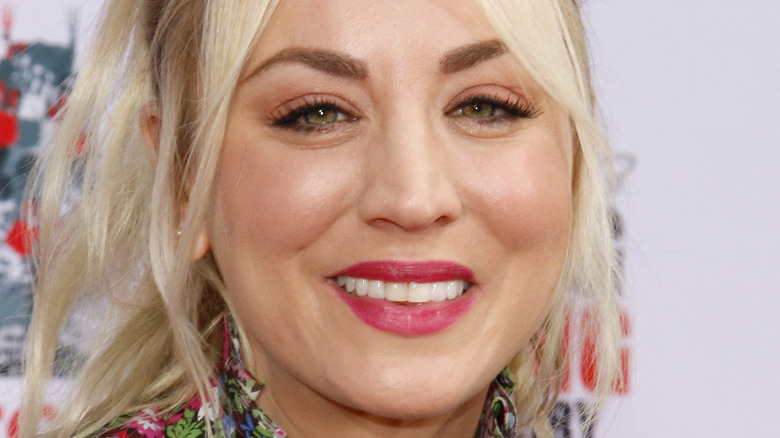 Kaley Cuoco smiles with pink lipstick