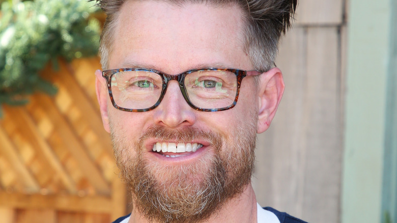Chef Richard Blais smiles with glasses and a beard