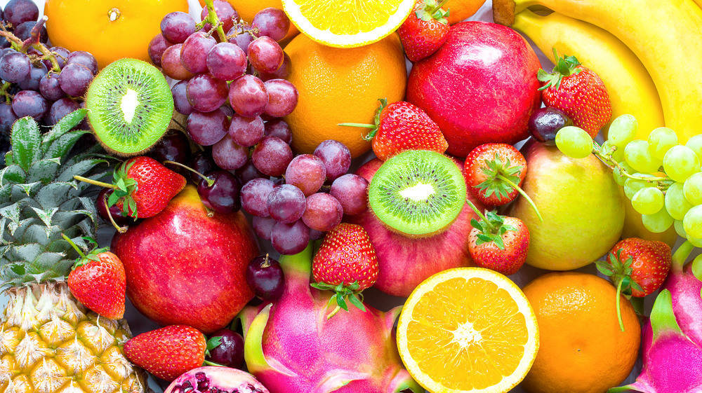 large variety of mixed fruit filling entire image