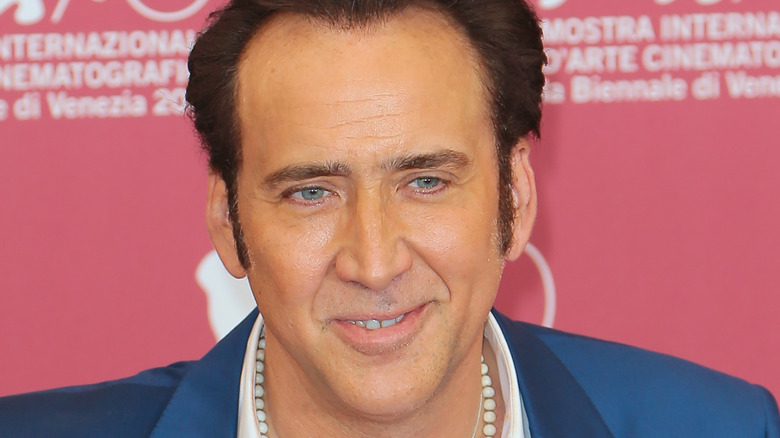 Nicolas Cage against pink background