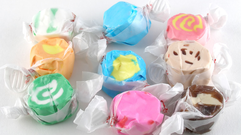 Colorful salt water taffy in wrappers
