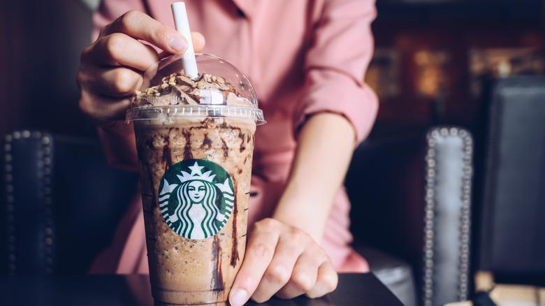 A barista and Starbucks Frappucino