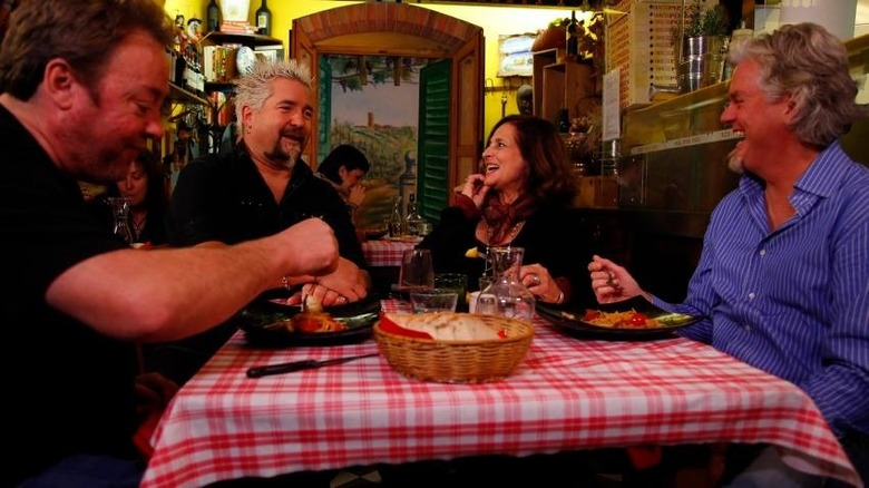Guy Fieri dining with customers
