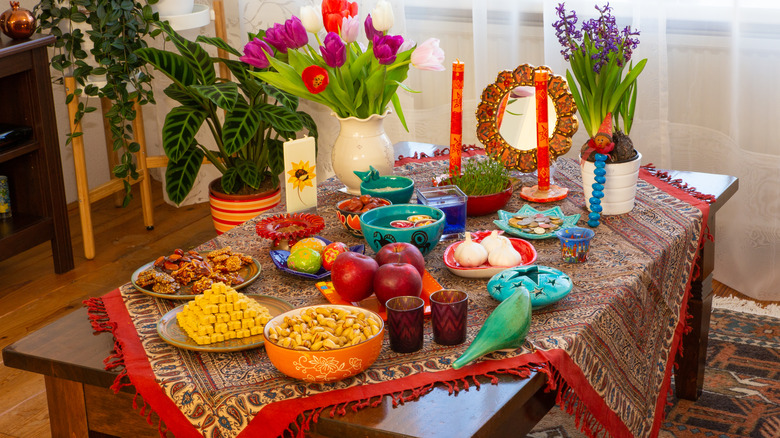 Haft Sin table with flowers and candles