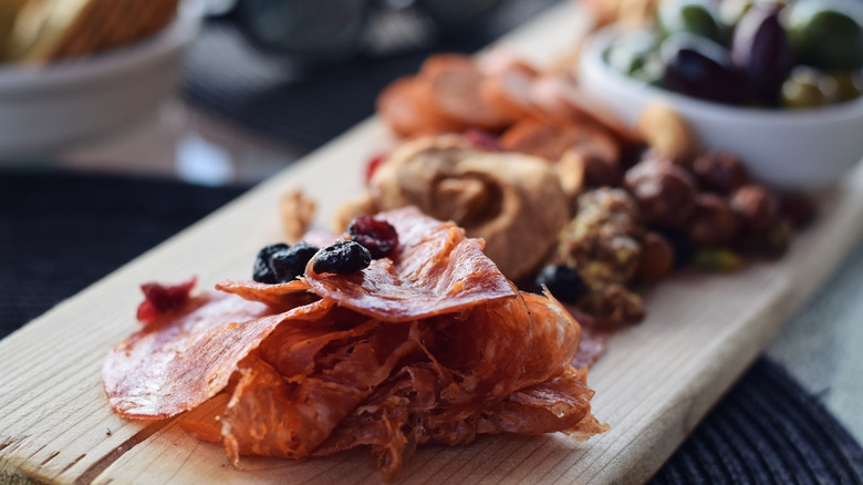 charcuterie board with cured meats