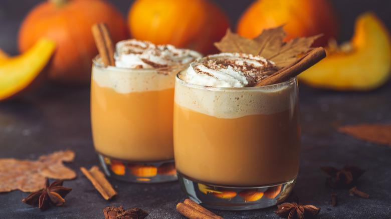 Pumpkin spice lattes with cinnamon sticks