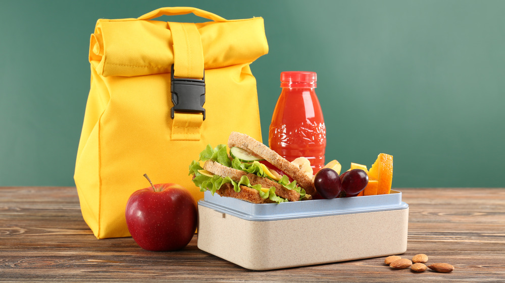 Yellow lunch sack with a lunch box with healthy food