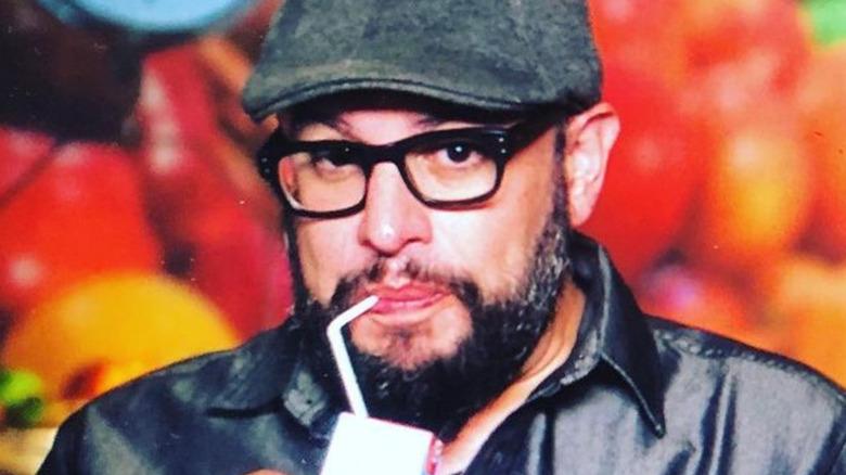 Carl Ruiz drinking juice box