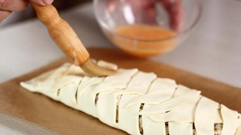 Egg wash brushed on dough