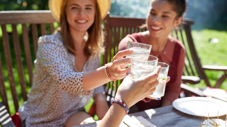 Women clinking their cocktail glasses together