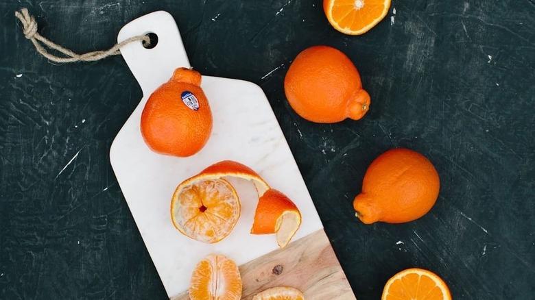 Sunkist citrus fruits on cutting board