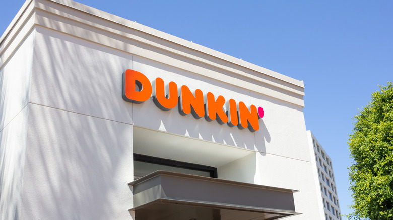 White building with Dunkin' logo
