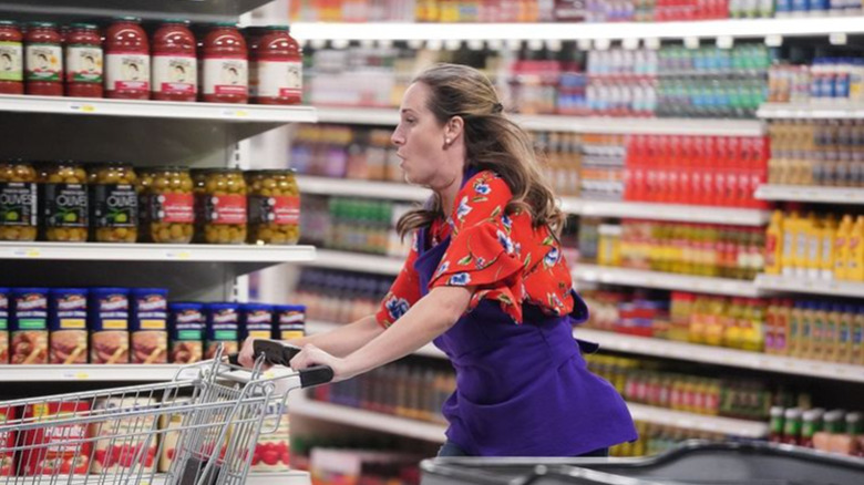 Woman racing through grocery store