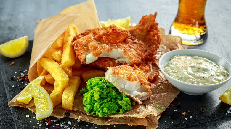 fish and chips with vinegar behind it