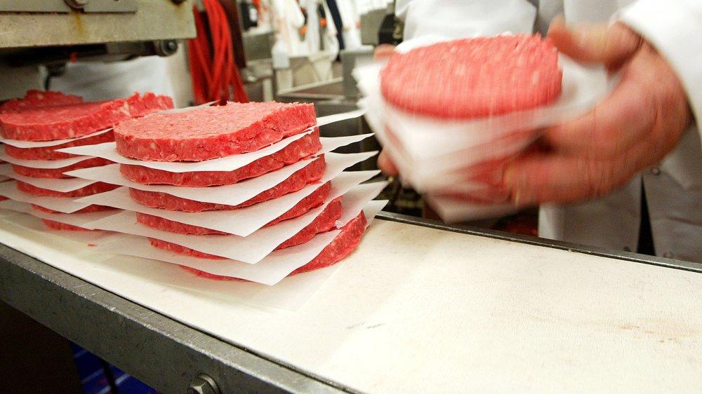 Ground beef patties being proceessed