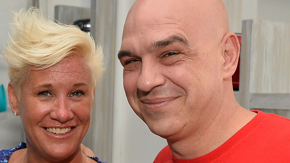 Anne Burrell and Michael Symon smiling