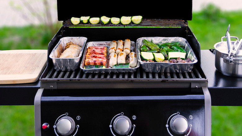 Barbecue loaded with different foods