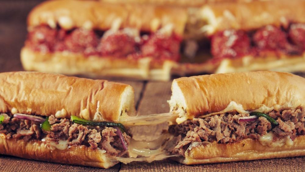 Three Subway footlong sub sandwiches