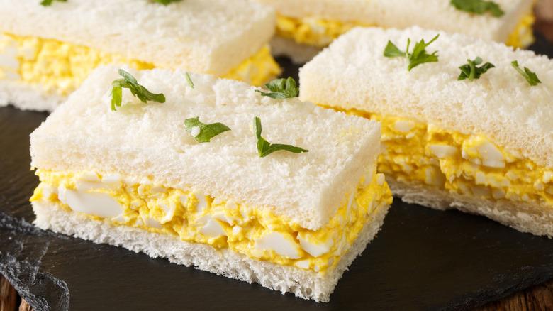 Platter of egg salad sandwiches