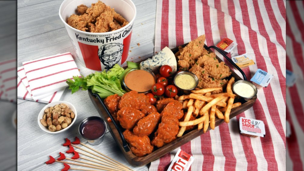spread of chicken, wings, and fries with new sauce