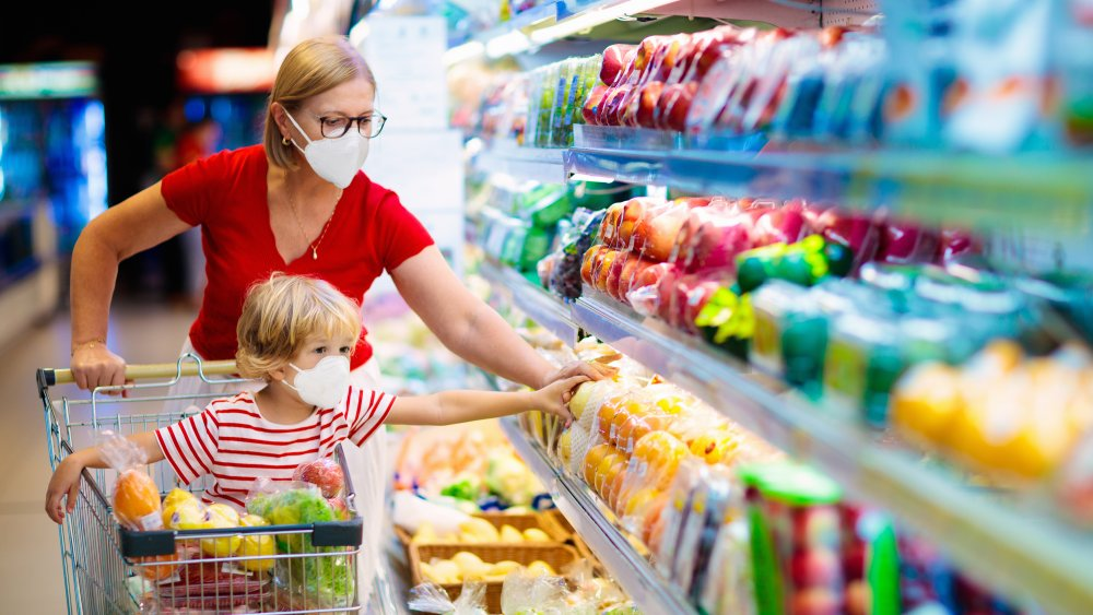 woman shopping for fruit