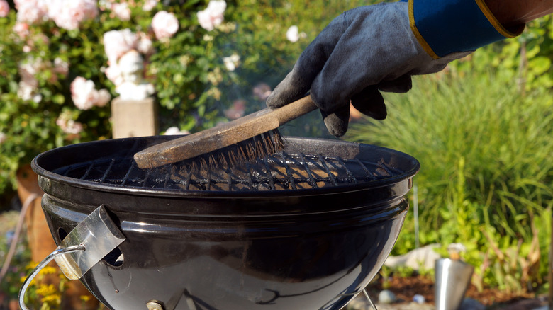 Cleaning grill with a brush