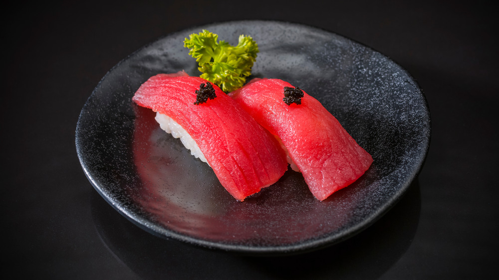 Tuna nigiri on black ceramic plate