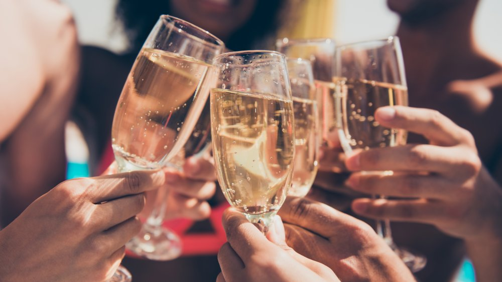 Cheers of champagne flutes