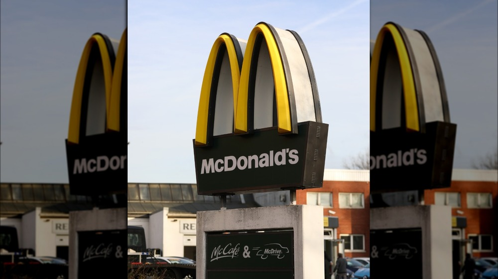Golden Arches with black sign