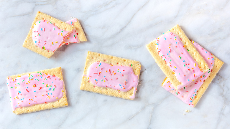 Pink frosted Pop-Tarts on a white marble background