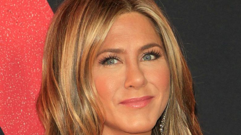 Jennifer Aniston in front of a dark background