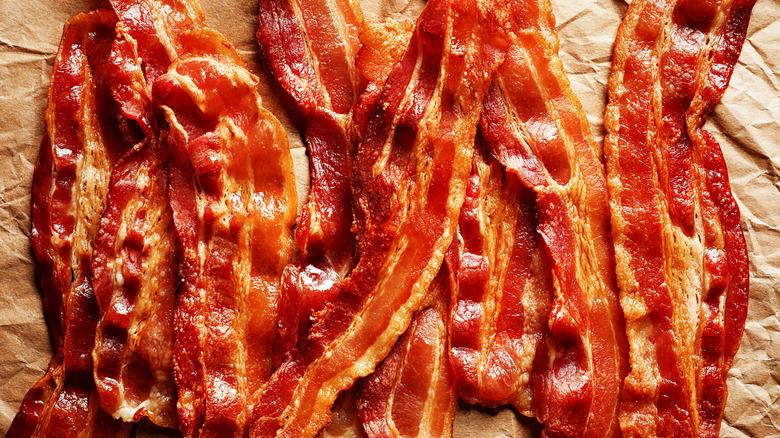 streaky bacon on brown paper