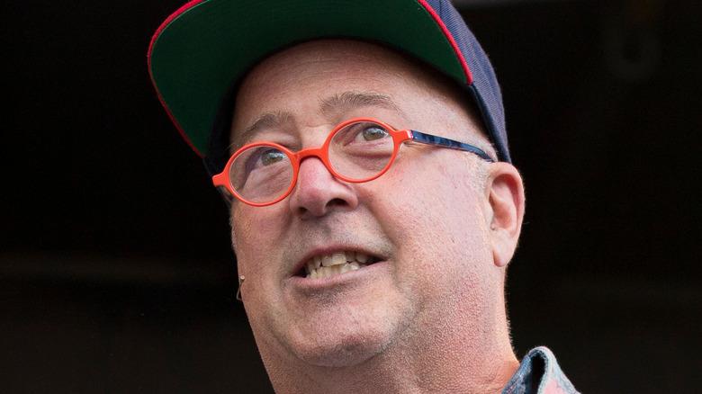 Andrew Zimmern wearing cap