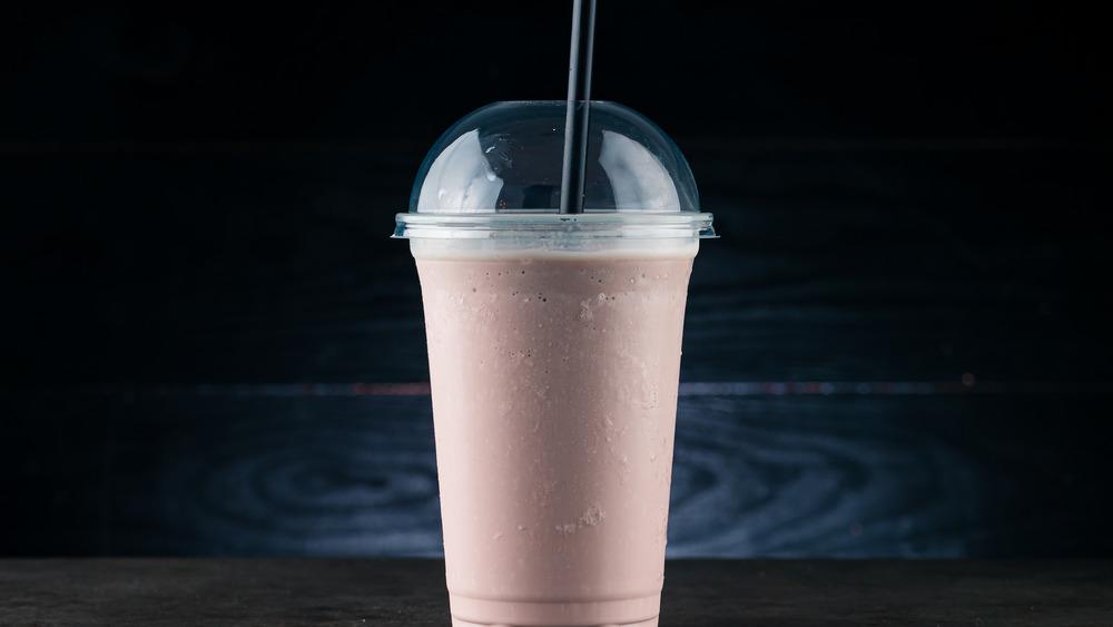 Chocolate milkshake in lidded platic cup
