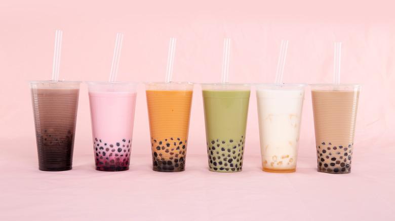 A row of multi-colored bubble teas