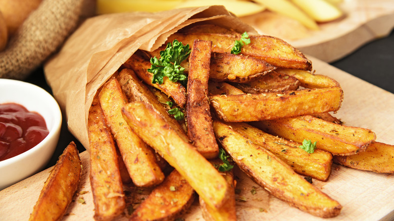French fries in a bag with parsley