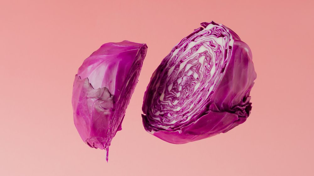 A red cabbage sliced in half