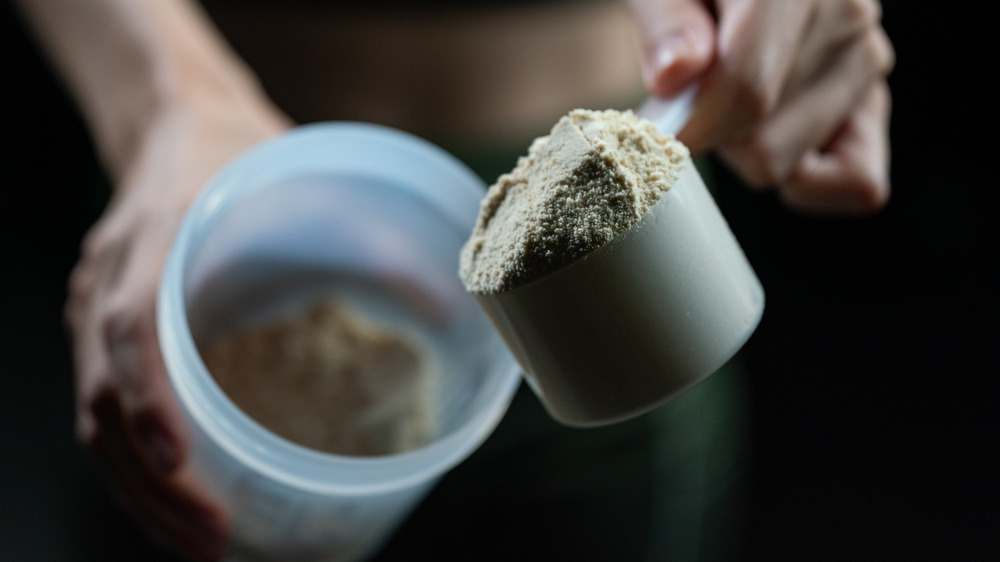 scooping protein into container