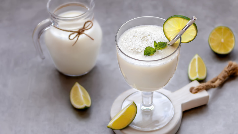 Whipped lemonade in glass jar and pitcher