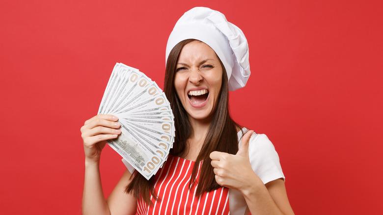 Happy chef flashing cash