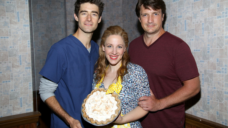 """Actors of Broadway's """"Waitress"""" holding a pie"""
