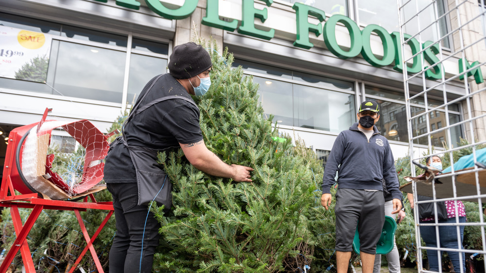 Whole Foods employee with Christmas tree