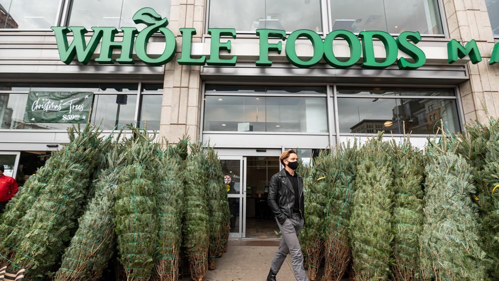 Christmas trees outside Whole Foods