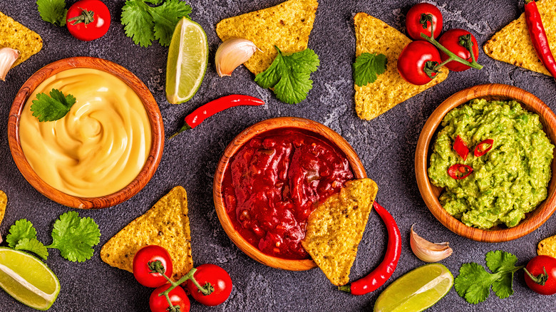 tortilla chips and dip with vegetables