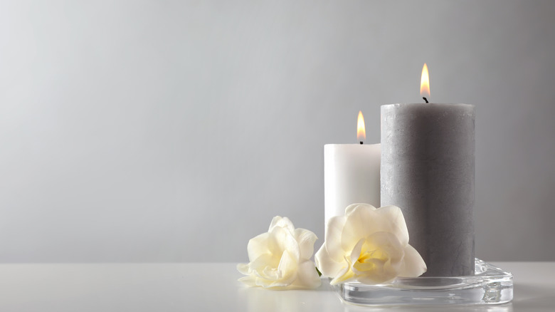 Scented candle on gray background
