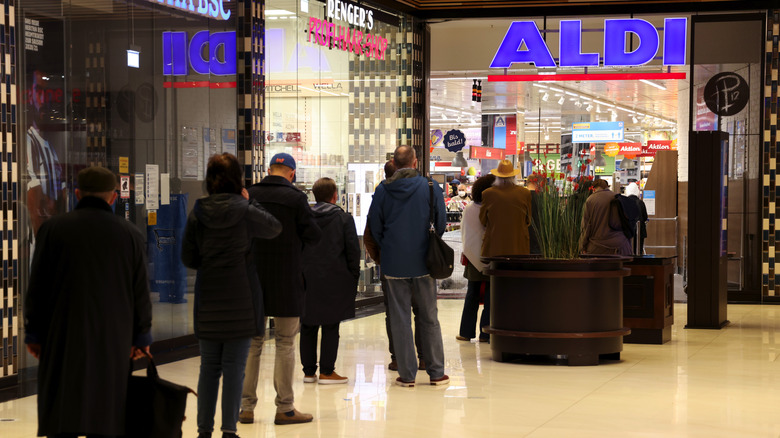 people lined up outside Aldi