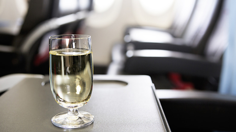 glass of wine in an airplane cabin